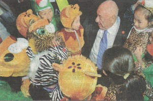 Philanthropist Kenneth E. Behring talks with children about animals.